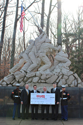 Chrysler Group's Mid-Atlantic Business Center Presents $150,000 to Toys for Tots Foundation. Pictured from L to R: Marine Corps Member, Charlie Glymph (MABC Marketing Manager), Steve Zanlunghi (MABC Director), Lt. General Pete Osman (USMC Toys for Tots Rep), Major Bill Grein (USMC Toys for Tots Rep) and Marine Corps Member. These individuals are pictured in front of the Iwo Jima memorail at the U.S. Marine Corps base entrance in Quantico, Va.  (PRNewsFoto/Chrysler Group LLC)