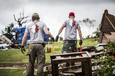 Team Rubicon volunteers clear debris after a storm.Photo courtesy of Team Rubicon.