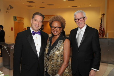 """California Science Center President and CEO Jeffrey Rudolph, California Science Center Foundation Trustee Paula Madison, and NBC4 weathercaster and auctioneer for the gala Fritz Coleman enjoy the 16th annual Discovery Ball, which raised more than $1.35 million to benefit the California Science Center Foundation. As part of the festivities, guests previewed """"Pompeii: The Exhibition"""" which opened on Tuesday, May 20th. (PRNewsFoto/California Science Center)"""