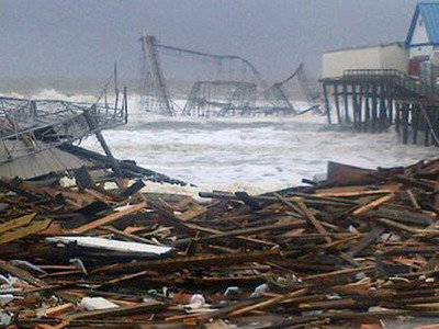 Damage to Seaside Heights Boardwalk, the Star Jet rollercoaster is hanging into the Atlantic Ocean.  (PRNewsFoto/Claims Strategies Group and Sandyclaims.org)