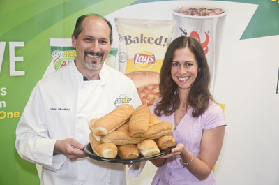 SUBWAY(R) bread is now fortified with Calcium and Vitamin D. SUBWAY Corporate Dietician, Lanette Kovachi, RD and Global Baking Specialist, Mark Christiano show that each 6 inch sandwich portion now has the calcium equivalent as one glass of milk, making it the perfect way to complete a healthful and delicious sandwich.  (PRNewsFoto/SUBWAY Restaurants, Jeff Glagowski)