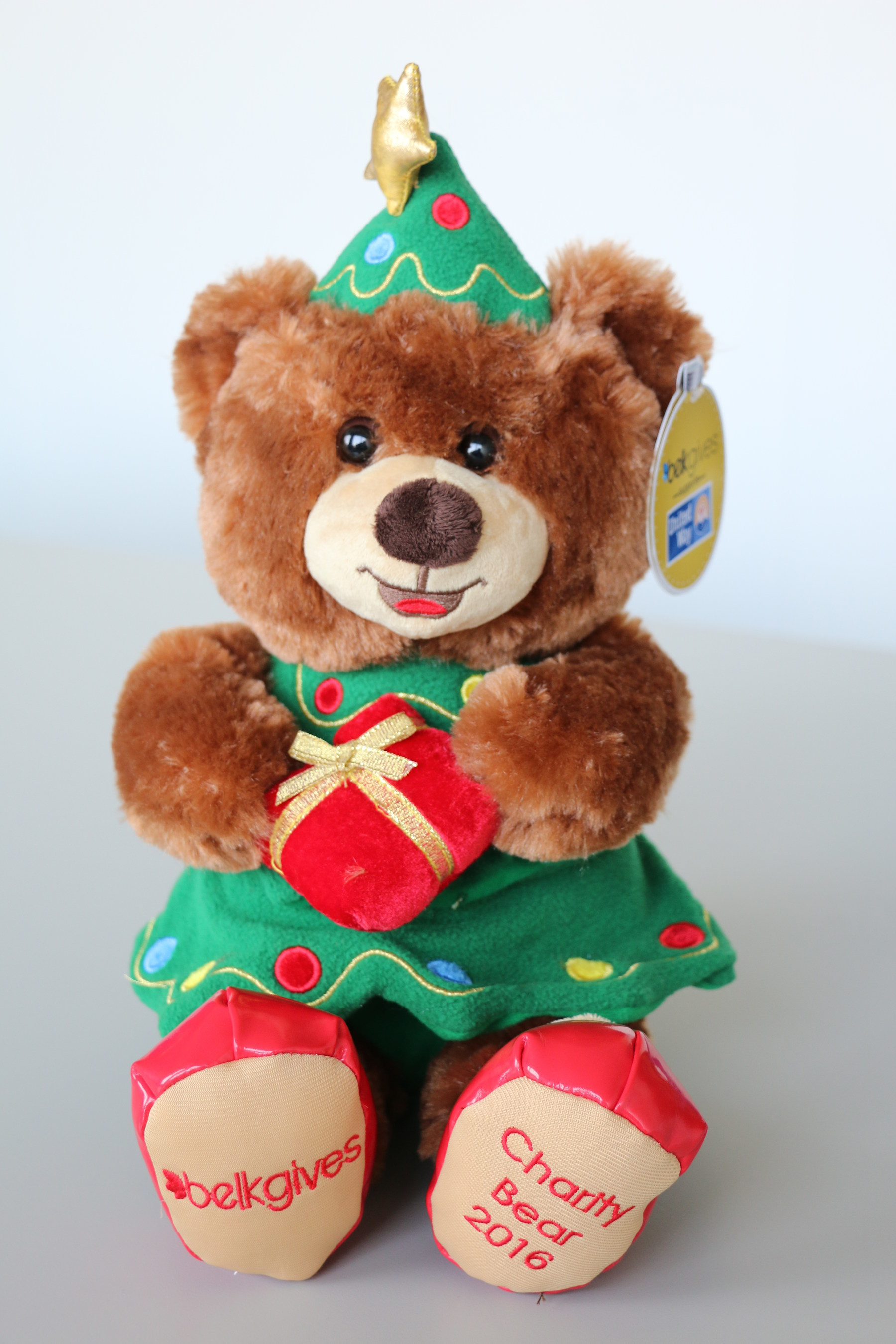 The 2016 Belk Charity Bear was designed by a 9-year-old girl at last year's Belk SantaFest event. Charity Bear is available on belk.com and in most stores.