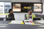 On her work placement at Hertz, Kingston College Travel & Tourism Level 3 student Davida Arhin learns about Hertz Gold from Customer Service Representative Abel Kahuni. Hertz and Kingston College connected through the Global Travel and Tourism Partnership.