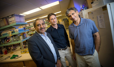 From left, UC San Diego Chancellor Pradeep K. Khosla with researchers Valentino Gantz and Ethan Bier