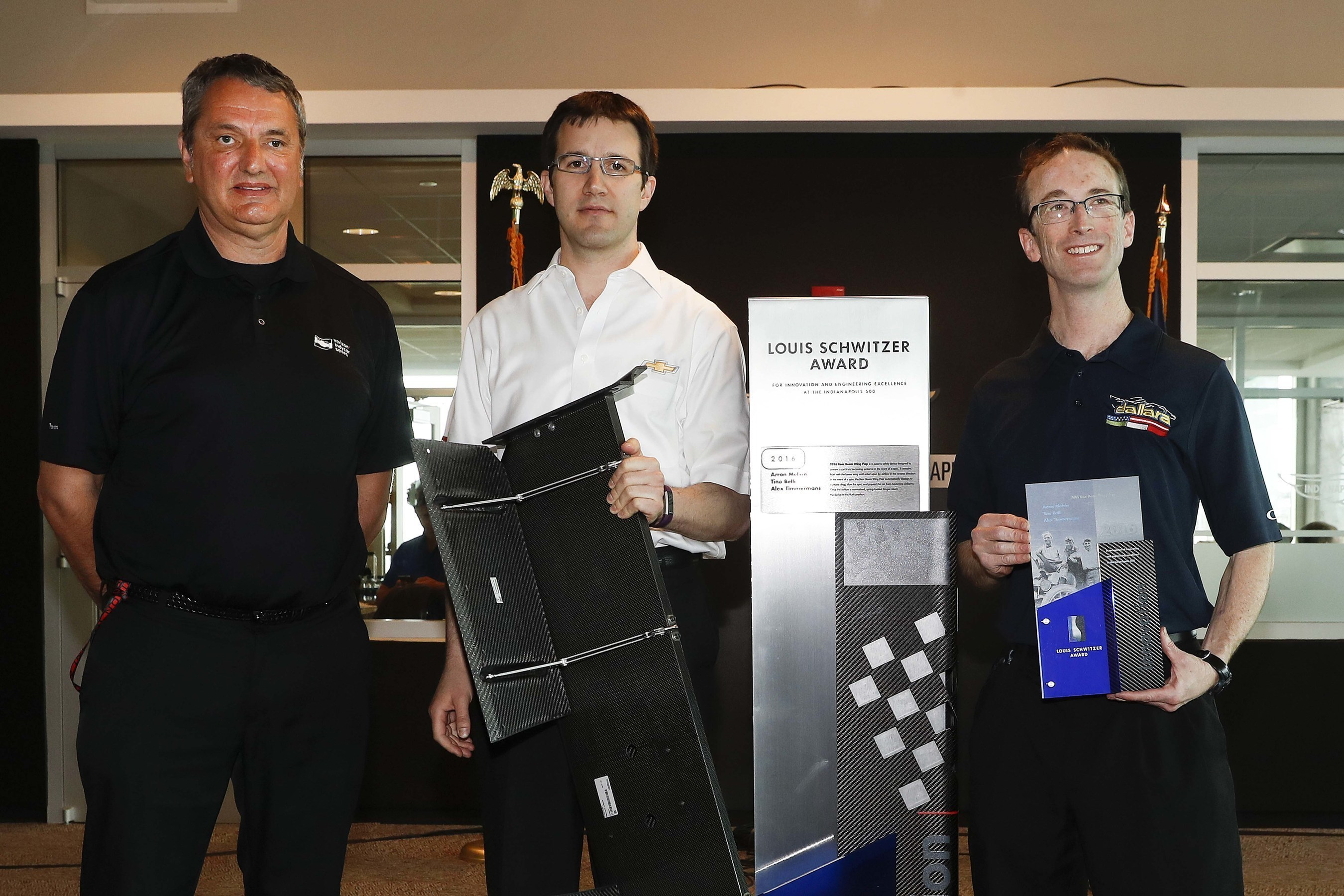 Standing with the Louis Schwitzer Award trophy (left to right) were award winners Tino Belli from INDYCAR, Arron Melvin from Chevrolet, and Alex Timmermans from Dallara for the Rear Beam Wing Flap.