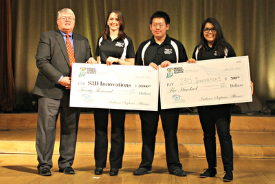 Three Purdue engineering students earned the top prize of $20,000 by developing a recyclable 3D printing material for the 2014 Student Soybean Product Innovation competition sponsored by Indiana Soybean Alliance. From left, ISA President David Lowe presents a check to Team Filasoy members Nicole Raley, Yanssen Tandy and Carmen Valverde-Paniagua.  (PRNewsFoto/Indiana Soybean Alliance)