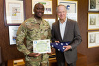 Army National Guard Spc. Anthony Cappel presents Realogy Chairman, Chief Executive Officer and President Richard A. Smith with an American flag on July 1 in Madison, N.J. The flag was personally flown for Realogy over the Camp Five detention facility in Guantanamo Bay, Cuba, by Cappel for a ceremonial time of nine minutes, 11 seconds on September 11, 2015, as a tribute to those who lost their lives during the terrorist attack on the United States on September 11, 2001, and to those who continue the fight...