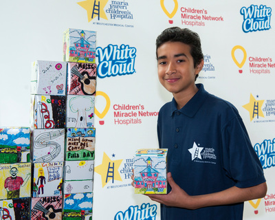 14-year-old Ryan Reyes from Brooklyn, N.Y., shares his grand prize winning design from the second annual White Cloud National Facial Tissue Box Design Contest with Children's Miracle Network Hospitals. Photo provided by Heather E. Smith (PRNewsFoto/White Cloud) (PRNewsFoto/White Cloud)