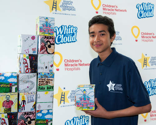 14-year-old Ryan Reyes from Brooklyn, N.Y., shares his grand prize winning design from the second annual White Cloud National Facial Tissue Box Design Contest with Children's Miracle Network Hospitals. Photo provided by Heather E. Smith (PRNewsFoto/White Cloud)