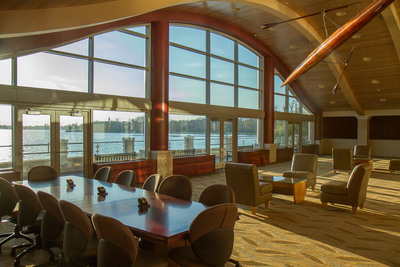 CULVER, Ind. - An antique single scull hangs from the ceiling of the Huffington Alumni Lounge in the White-DeVries Rowing Center at Culver Academies. The second-story lounge opens onto a balcony to allow guests to watch rowing, sailing, and other lakeside events. The specially-crafted coffee tables are seats from racing shells with glass covers. The lounge also highlights the history of competitive rowing at Culver, which dates back to 1921.  (PRNewsFoto/Culver Academies)