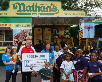 Nathan's Famous representatives presented the Johnston Family YMCA with a Food Lion gift card worth $1,000 towards the purchase of groceries, courtesy of Nathan's Famous.
