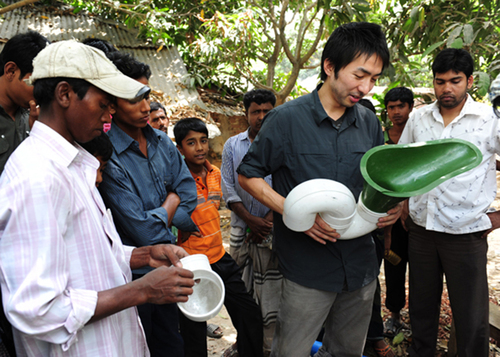 Daigo Ishiyama, engineer and industrial designer at American Standard, researched and then field tested the SaTo sanitary toilet pan, developed to improve sanitation and reduce the transmission of disease from pit latrines in Bangladesh. His learning will help the company create an appropriate sanitation solution for residents Sub-Saharan Africa, who live with a scarcity of water.  (PRNewsFoto/American Standard Brands)