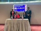 Wang Yuyun, President of Perfect World Education, and Nigel Seaton, Principal of Abertay University, sign a cooperation agreement at the China-UK Creative Innovators Forum.