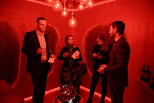 Participants in the red room (PRNewsFoto/Story PR)