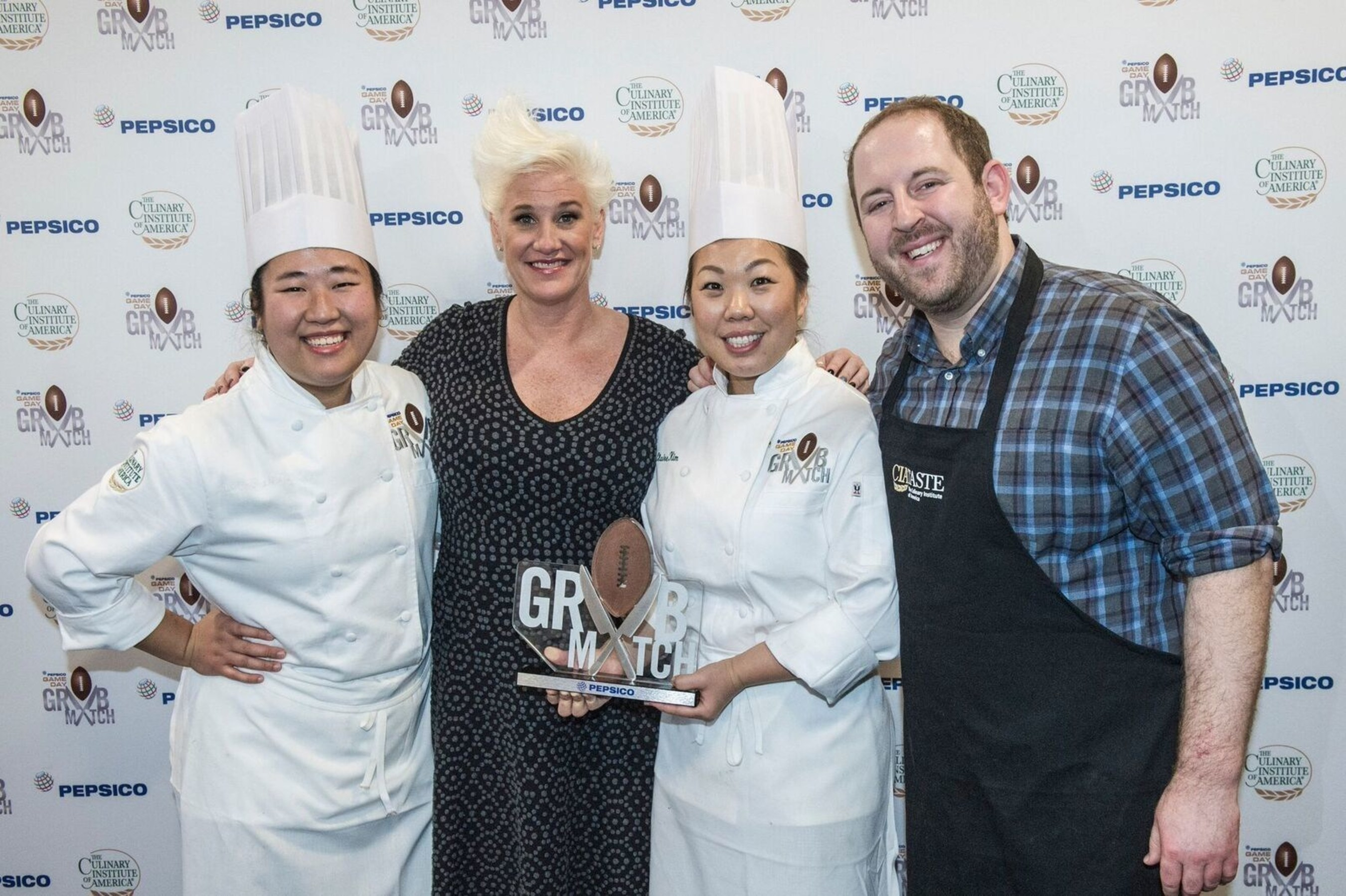 Food Network Chef Anne Burrell with the winning team of PepsiCo's Game Day Grub Match