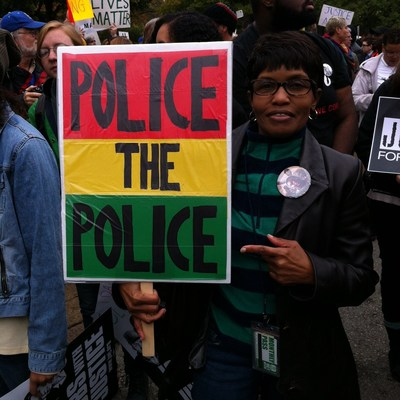"This ""Police the Police"" poster was carried by Beverly Adams, of University City, Mo., during a protest in October. The poster is among the items Shahid acquired for the Newseum's collection."