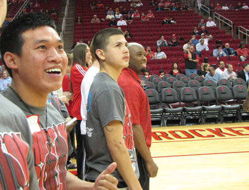 Students from the JA Job Shadow stand in excitement on the Toyota Center court to watch the Houston Rockets ...