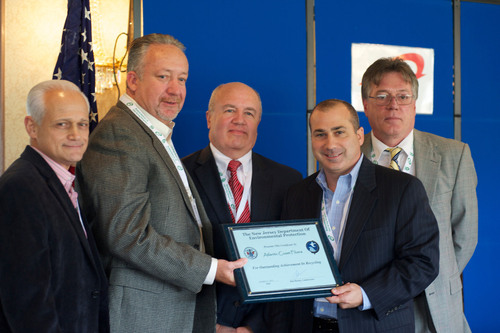 Allan Zozzaro, Rick Ramsay, John Stanton and Chris Riviello proudly receive prestigious recycling award from Guy Watson of the NJ DEP.  (PRNewsFoto/Atlantic Coast Fibers, LLC)