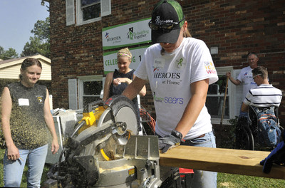 Sears volunteers cut wood while building a wheelchair ramp for a veteran's home. Sears is bringing back its Heroes at Home program for the holiday season to immediately assist low-income veterans who are in urgent need of wheelchair accessibility ramps. Starting Oct. 30 through Nov. 19, members can donate to Rebuilding Together, a leading national nonprofit in safe and healthy housing, when they check out at any Sears store, or via a link at sears.com/heroesathome.