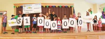 Tropical Smoothie Cafe CEO Mike Rotondo presents $1million check to the brand's national charity partner, Camp Sunshine.Thousands of children and their families have benefited from the brand'sten-year charitable effort on National Flip Flop Day.
