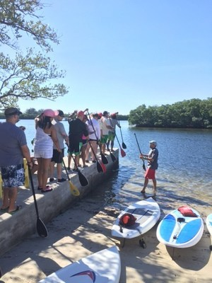 Injured veterans and their families received a history of stand up paddleboarding and learned techniques to hone their skills.
