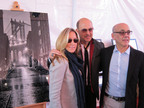 John Varvatos welcomes Nancy Loving of LIK USA and Coppy Holzman of Charitybuzz to the event.  (PRNewsFoto/LIK USA)