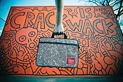 Manhattan Portage and the Keith Haring Foundation have collaborated on a nine-piece, limited edition bag collection that features some of the eye-popping artwork Haring designed in 1988 for his Tokyo Pop Shop.  (PRNewsFoto/Manhattan Portage)