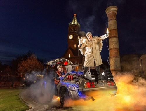 Marty (Dan Gordon) and the Harp Angel, pictured alongside their Belfast-built time machine at The Gasworks Clock, Belfast. (PRNewsFoto/Harp) (PRNewsFoto/Harp)