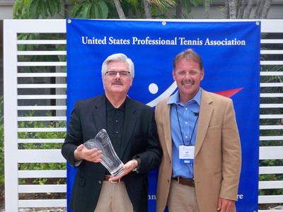 "BallenIsles GM Derrick Barnett (left) receives ""Facility Manager of the Year"" Award from Jeff Cohen, USPTA Florida Division President. (PRNewsFoto/BallenIsles Country Club)"