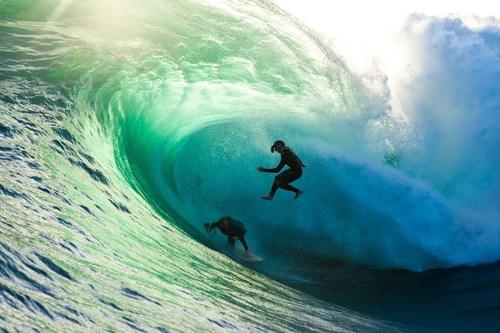 Mark Mathews defies death while shooting World First #VirtualRealitySurf when skimboarder Brad Domke crashes through the wave. (PRNewsFoto/Garage Entertainment)