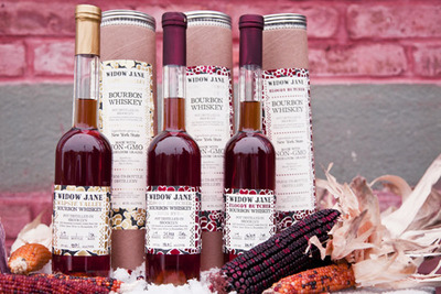 Each bottle of Wapsie Valley, Bloody Butcher, and Bloody Butcher High Rye Bourbon Whiskey is handsomely packaged in a tube box with a collectable print and a few kernels of our corn.  (PRNewsFoto/Widow Jane)
