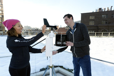 The Weather Company Meteorologist, Jess Parker (left) works with IBM Watson Developer Chris Ackerson (right) to install a personal weather station on the roof of IBM Watson Headquarters at Astor Place in New York City. IBM today announced that it has closed the acquisition of The Weather Company's B2B, mobile and cloud-based web-properties, weather.com, Weather Underground, The Weather Company brand and WSI, its global business-to-business brand. (Jon Simon/Feature Photo Service for IBM) Media Contact: Vineeta Durani, VP, IBM Communications, (917) 855-2680, vineeta.durani@us.ibm.com