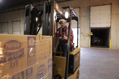 In Somerset New Jersey, an American Red Cross volunteer unloads Nestlé Pure Life® bottled water headed for shelters and other emergency needs. Nestlé Waters North America has donated more than 775,000 bottles of water to help victims of Hurricane Sandy.