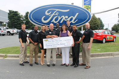 Shawn Lynes, GM, Sheehy Ford Lincoln of Gaithersburg along with Sheehy employees presented check for $162,000 to Adrienne Johnson, Global Race for the Cure Project Manager.  (PRNewsFoto/Sheehy Auto Stores, Inc.)