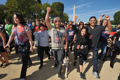 Cesar Millan leads participants and their pets around the National Mall at the Second Annual National Family Pack Walk on Saturday Sept. 29, 2012, in Washington. (PRNewsFoto/Larry French/Invision for Warner Bros. Consumer Products/AP Images)