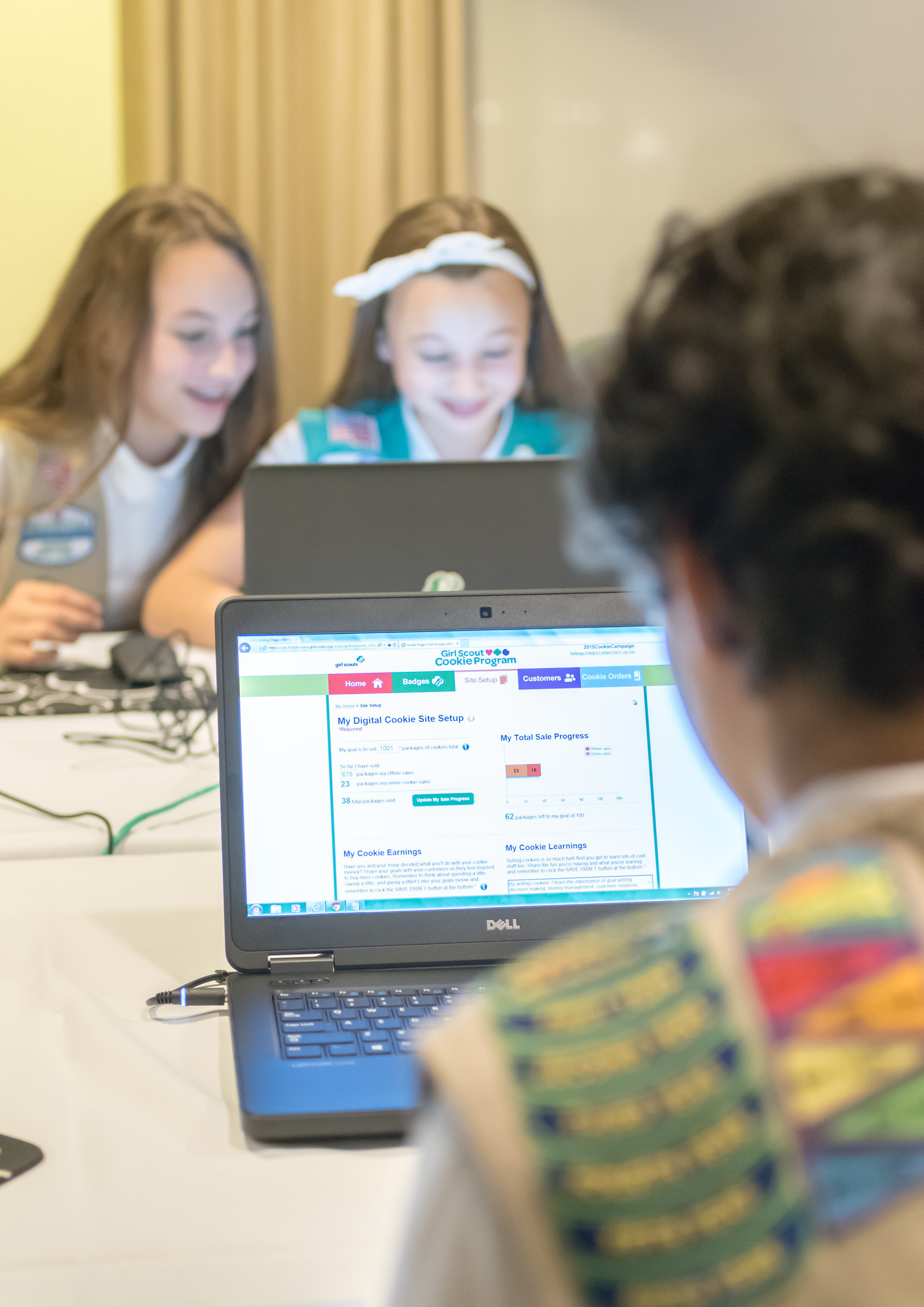 Girl Scouts Olivia and Isabella experience Digital Cookie for the first time.