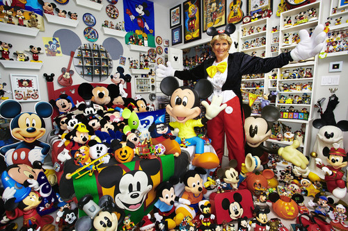 "Janet Esteves has amassed the ""Largest Collection of Mickey Mouse Memorabilia"" since she began her collection in 1960 as a child. The Guinness World Records 2011 book counts her collection at 2,760 different items. Photo Credit: Paul Michael Hughes/Guinness World Records. (PRNewsFoto/Guinness World Records, Paul Michael Hughes)"