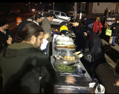Chef John Keller feeds Hurricane Sandy Victims at Guyon Relief in Staten Island NYC at the Dinner on Ludlow Relief Kitchen.  (PRNewsFoto/Dinner on Ludlow)