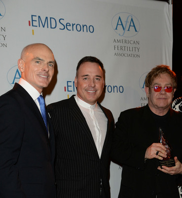Sir Elton John and David Furnish receive The American Fertility Association's Advocacy Award from board of directors member Guy Ringler, M.D.(PRNewsFoto/The American Fertility Association) (PRNewsFoto/THE AMERICAN FERTILITY ASSOCI...)