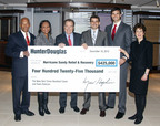 Hunter Douglas announced that it has donated a total of $425,000 to two nonprofits - The New York Times Neediest Cases Hurricane Sandy Relief Effort and Team Rubicon - to help relieve the suffering and aid the recovery of those most in need following Hurricane Sandy.  President and CEO Marv Hopkins presented the check to Desiree Dancy, VP of The New York Times Neediest Cases Fund, and Team Rubicon Co-Founders Jake Wood, President, and William McNulty, VP.  From left to right, Gordon Khan, Hunter Douglas SVP and CFO; Desiree Dancy; Marv Hopkins; William McNulty; Jake Wood; Mindy Fabrikant, Hunter Douglas VP of Corporate Human Resources.  (PRNewsFoto/Hunter Douglas Inc.)