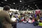 Gustavo Dudamel, Director of Los Angeles Philharmonic, and LeaLA Ambassador, reads to children at Spanish language book fair of Los Angeles. By LeaLA 2015.
