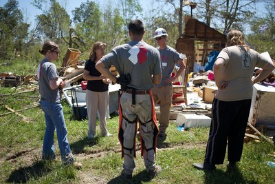 Team Rubicon assess the damage during a disaster response operation in Louisburg, Mississippi.