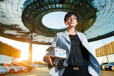 Dr. Jin Yan Shao showcases a prototype of a mobile and compact environmental monitoring unit, at the IBM Research lab in China. IBM is announcing that it will expand its Green Horizons initiative globally to enable city governments, utility companies and factories to better understand and improve their relationships with the environment and to help tackle pressing issues related to air pollution and climate change (credit: IBM)