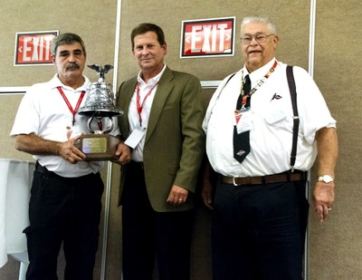 Jimmy Faulkner of Dallas Fire Rescue receives Spartan Motors' William Foster award. Pictured left to right: Jimmy Faulkner, John Slawson, and Bill Foster.