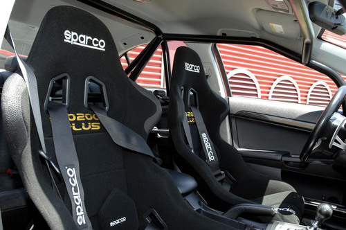 Roll cage and Sparco race seat as equipped for new Lancer Evolution II vehicle.  (PRNewsFoto/Mitsubishi Motor ...