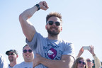 Joel McHale cheers the crowd during the Alaska Airlines Plane Pull with Russell Wilson, benefiting Strong Against Cancer at The Museum of Flight in Seattle on Tuesday, July 28, 2015. Team Wilson pulled the 737 in 16.9 seconds, with Team Joel coming in at over a minute.