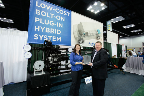 Echo Automotive, Inc. (Scottsdale, AZ), won The Work Truck Show(R) 2014 Green Award for its EchoDrive bolt-on hybrid electric kit for fleet vehicles. Steve Carey, executive director of NTEA­ - The Association for the Work TruckIndustry, presented the award to Amy Dobrikova, Echo Automotive VP sales &business development, last week during The Work Truck Show 2014 at the Indiana Convention Center in Indianapolis, IN.  (PRNewsFoto/NTEA)