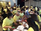 EY professionals along with the New York City Office Managing Partner, Mark Besca, create craft kits for children with long term hospital stays for Project Sunshine