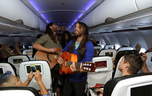 In this photo released by Virgin America, commercial guests onboard the airline's inaugural flight from San  ...