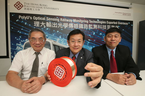 Professor Lee Kang-kuen (left), Professor of Transportation Practice, Department of Electrical Engineering, PolyU; Professor Tam Hwa-yaw (middle), Chair Professor of Photonics and Head of Department of Electrical Engineering, PolyU; and Dr Tan Chee Keong (right), Deputy Director, SMRT, Singapore. (PRNewsFoto/PolyU)